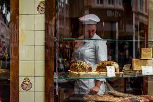 Baker Working in Bakery Shop Window